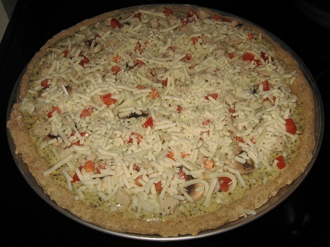 Take a break from traditional pizzas with this tasty option: Chicken Pesto Pizza. This pizza, with its rich, creamy topping, is affordable and easy to make.