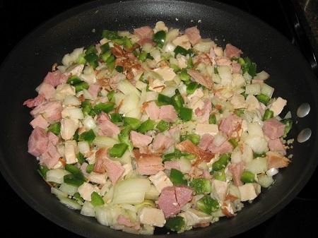 Ham chicken pepper onion and garlic in skillet