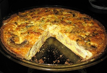 Quiche baked in Cauliflower Crust - slice removed | This delicious, easy-to-prepare quiche crust is made with nutrient-rich cauliflower. It's an easy way to sneak in a few extra veggies!