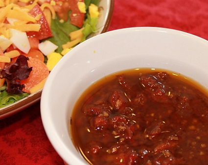 Sun-Dried Tomato Vinaigrette ready to serve | This easy-to-prepare Sun-Dried Tomato Vinaigrette adds some pizzazz to salads with its sweet and tangy flavor. It's also great as a marinade.