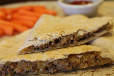 Cheeseburger Quesadillas close up | Cheeseburger quesadillas feature the classic taste of cheeseburgers in an easy-to-prepare quesadilla. Try this convenient, family-friendly dish tonight!