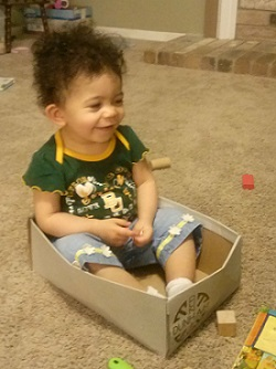 Amaris playing in a box
