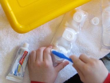 Toothbrush Water Play - Teach Preschool