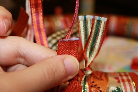 Applying glue to prevent ribbons from fraying