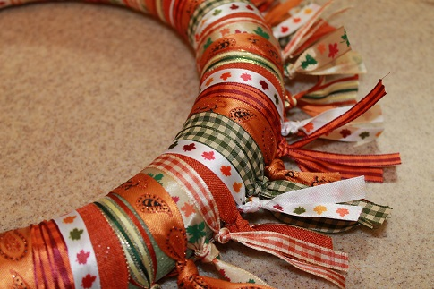 Ribbons tied around the wreath form for an Easy Fall Ribbon Wreath