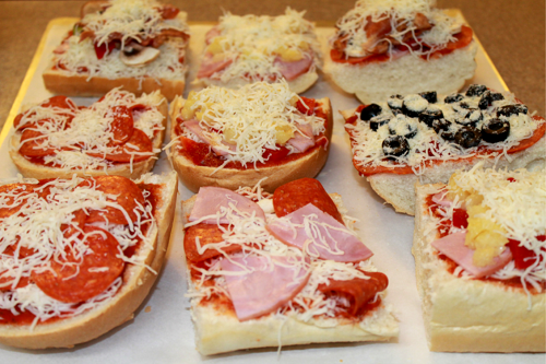 French bread pizzas ready for the oven